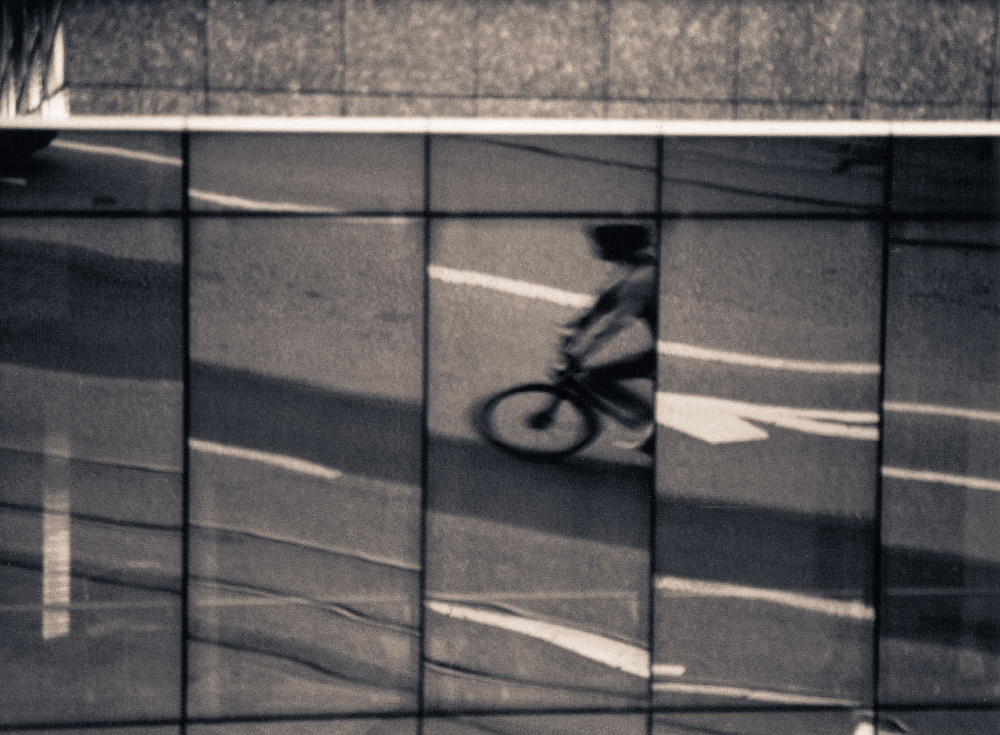 Reflections of a commuter, captured with the Minolta XD7