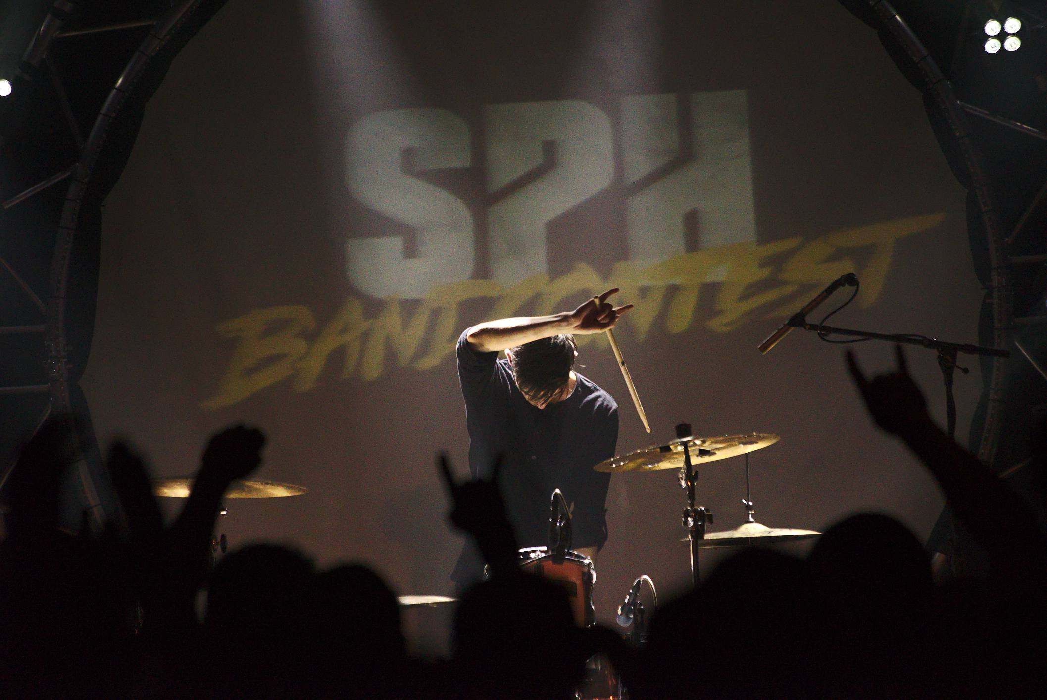 The drummer, finishing his solo with style